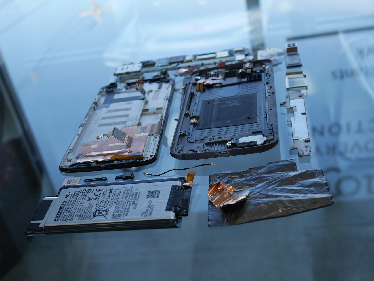 A Motorola Droid Turbo 2 phone taken apart for a mobile phone data recovery project.